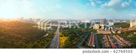 Panorama wide angle view cityscape,green park,terrace house and highway located at Kuala Lumpur,Malaysia . 62769503