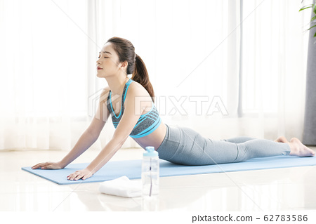 Women stretching yoga 62783586