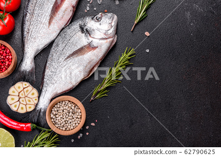 Raw dorado fish with spices  62790625