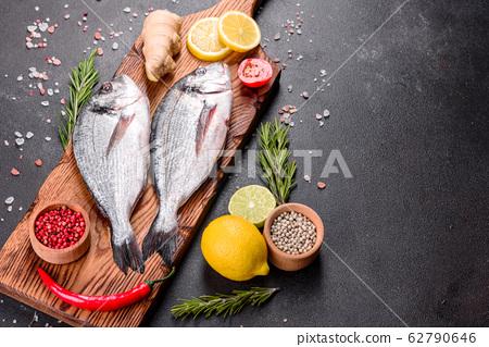 Raw dorado fish with spices  62790646