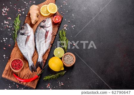 Raw dorado fish with spices  62790647