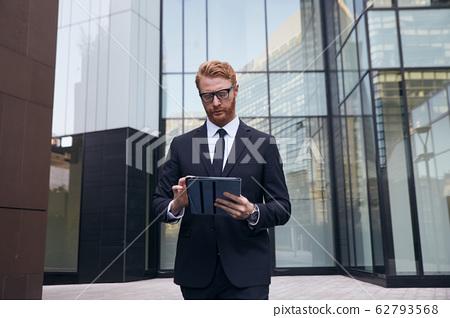 adult businessman shot in urban environment 62793568