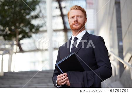 adult businessman shot in urban environment 62793792