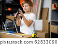 Cheerful little boy with pliers stock photo 62833090