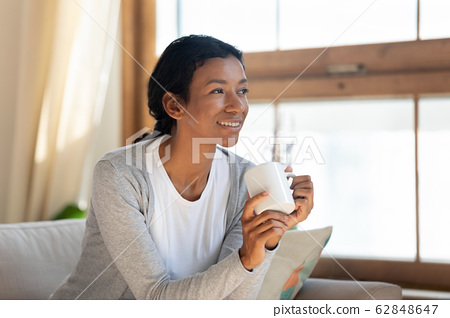 Smiling biracial woman look in distance dreaming 62848647