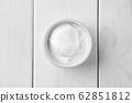 Top view of sour cream in ceramic gravy boat 62851812