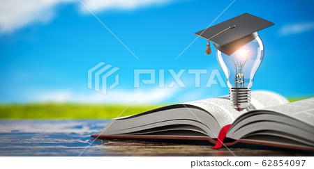 Open book with light bulb and graduation cap on 62854097