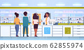 female doctor pharmacist giving pills to customers african american patients at pharmacy counter modern drugstore interior medicine healthcare concept horizontal full length 62855974
