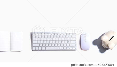 Computer keyboard with a piggy bank and a notebook 62864884