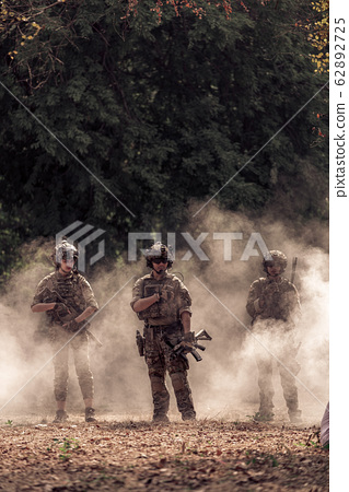 team of soldiers engaged in operation rescue 62892725
