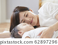 Baby and mother 62897296