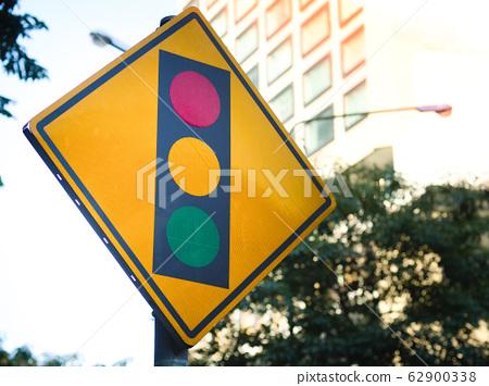 Traffic sign warns about traffic light warning. 62900338