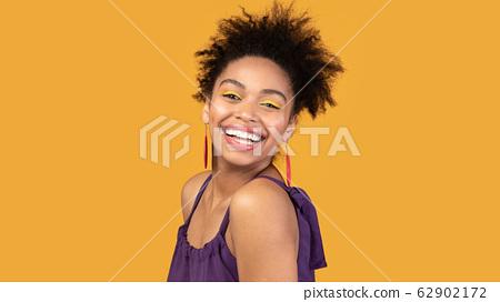Portrait of cute black girl smiling at camera 62902172