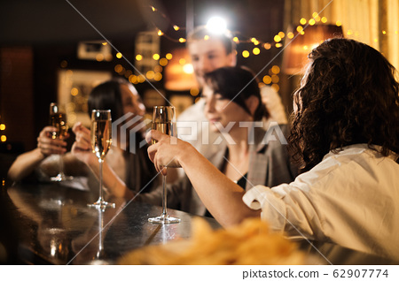 Happy group of friends at the bar having drinks. 62907774