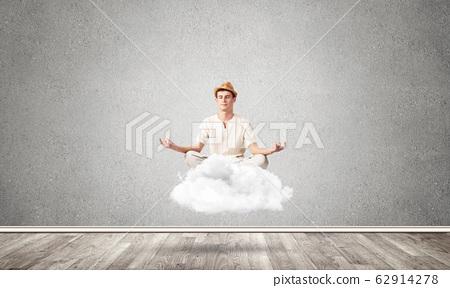 Young man keeping mind conscious. 62914278