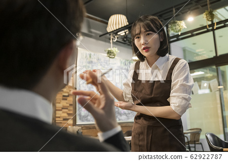 Portrait of young woman and man, part timer and owner 623 62922787