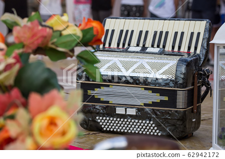 Classic musical instrument an accordion in black color 62942172