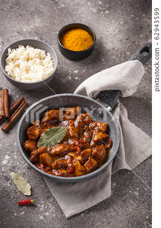 Curry chicken tikka masala with rice 62943599