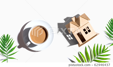 Cardboard house with a cup of coffee 62946437