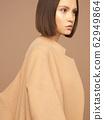 Fashion beautiful lady in beige coat 62949864