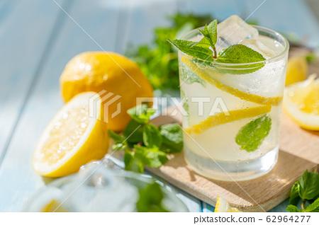 Lemonade and ingredients on blue wood background 62964277