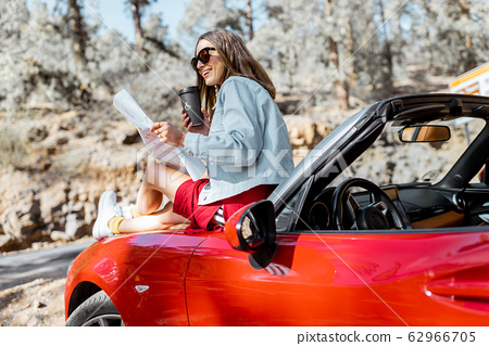 Woman traveling by car on nature 62966705