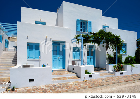 Traditional greek architecture houses painted white with blue doors and window shutters 62973149