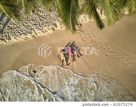Family on beach at Seychelles aerial top view 62975274