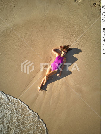 Woman on beach at Seychelles aerial top view 62975329