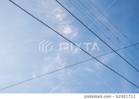 Electric wires stretched in the blue sky 62981712