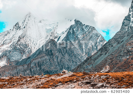Colorful in autumn forest and snow mountain at 62985480