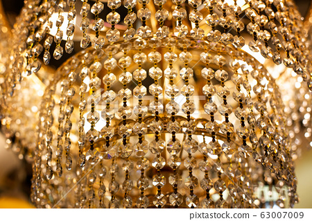 luxury chandelier close-up. Gold sparkling 63007009