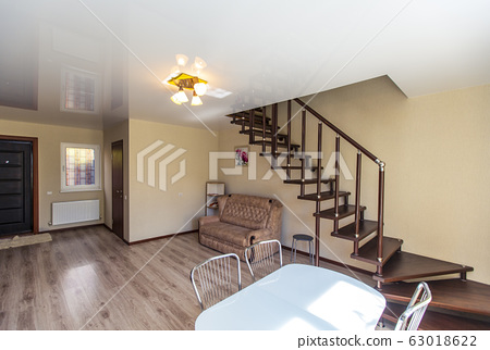 A dark wood wooden staircase with a shiny 63018622