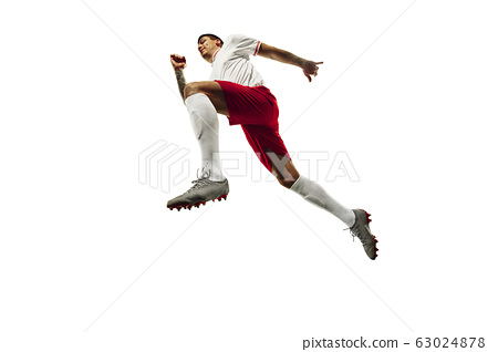 Football or soccer player on white background - motion, action, activity concept 63024878