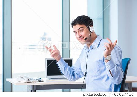 Male call-center operator in business concept 63027410