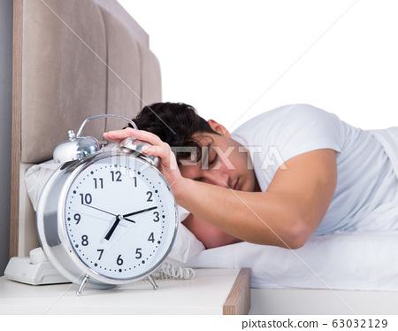Man in bed suffering from insomnia 63032129