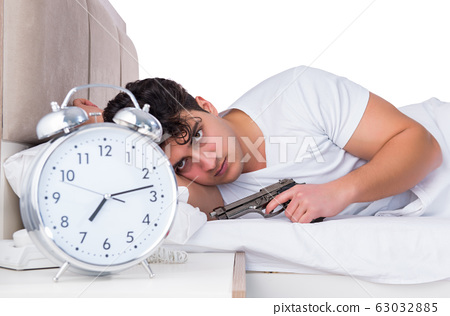 Man in bed suffering from insomnia 63032885