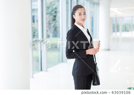 female staff standing in office 63039106