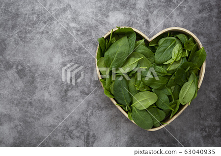 Fresh spinach leaves or spinach salad close up, background. Copy space. 63040935