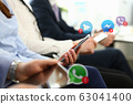 Group business people hold mobile device 63041400