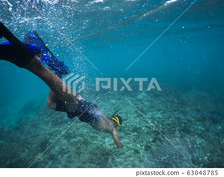 man free  diving in clear sea water 63048785
