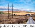 Typical power lines in rural landscape of Ireland 63050164