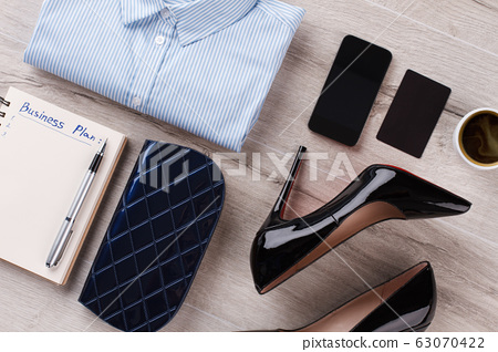 Office women's flatlay on table close up. 63070422