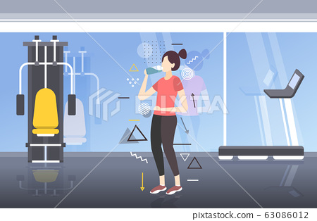 beautiful fitness athlete woman drinking water from plastic bottle after workout exercising healthy lifestyle concept modern gym interior horizontal full length 63086012