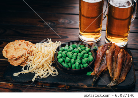 Selection of snacks and seafood two mugs of beer 63087140
