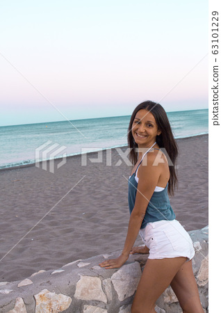 Slim young woman with positive attitude on the 63101229