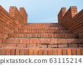 Looking up to the brick stairs. 63115214