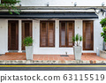 A beautiful exterior view of an restaurant with timber window and door. 63115519