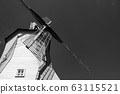 Looking upwards to the windmill building in black and white. 63115521