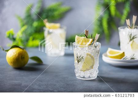 lemon soda cocktail with rosemary 63121703